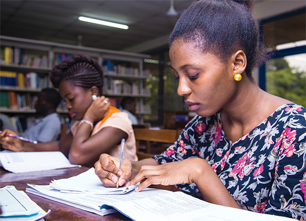 Undergraduate students learning at the Sam Jona library