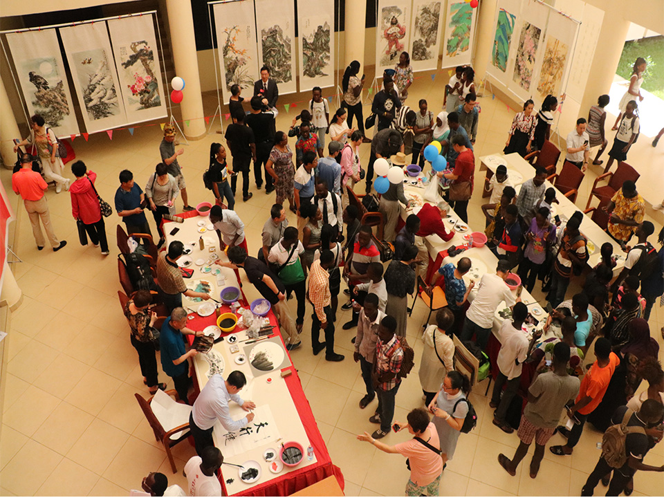 Some of the Chinese artistes painting at their  at the programme