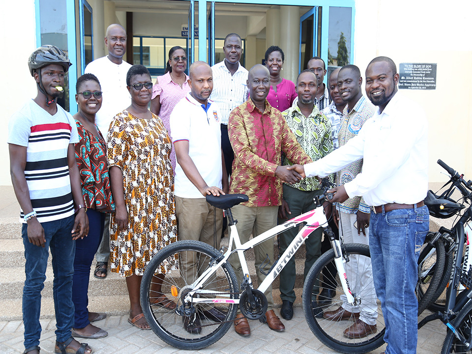 Mr. Ezekiel Arthur-Mends presenting the bicycles to Provost of CoDE, Prof. K. A. Galyuon