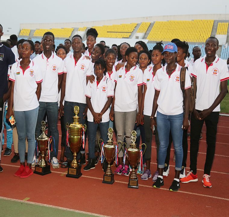 UCC team with trophies won at the 8th Mini GUSA Games