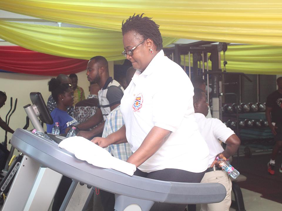 Prof. Dora Edu-Buandoh exercising on one of the sports power/exercise station