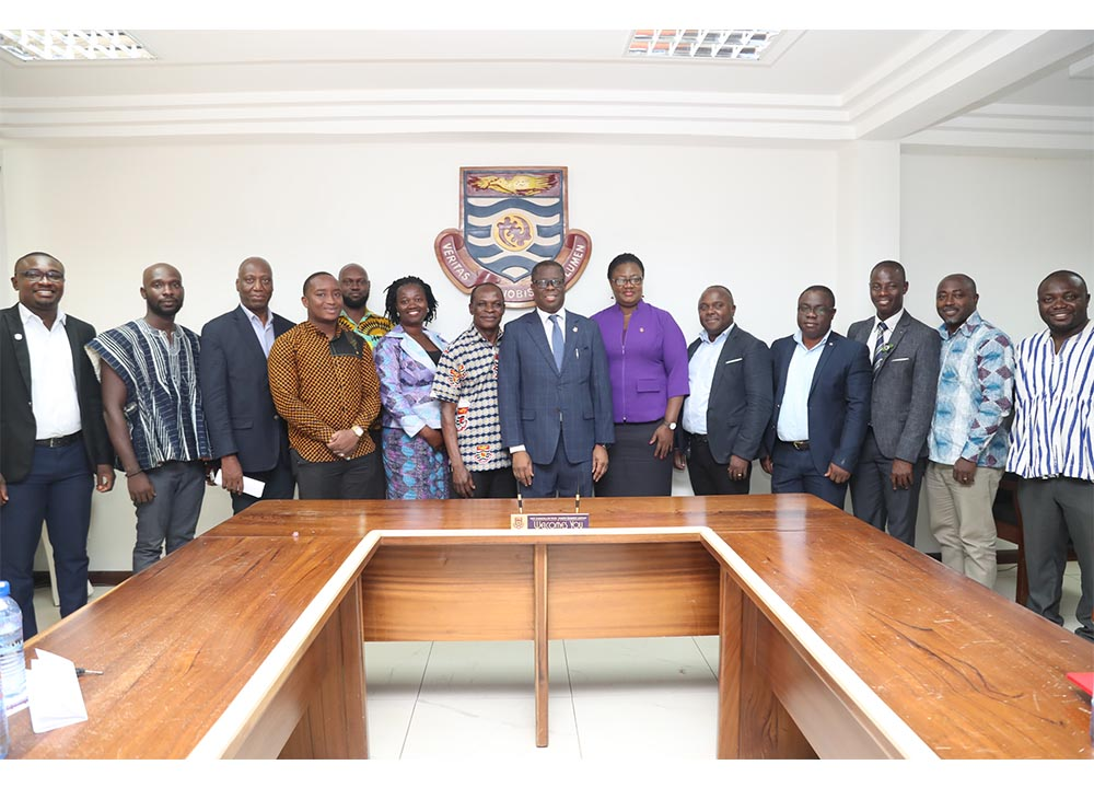 The Vice-Chancellor with members of the committee