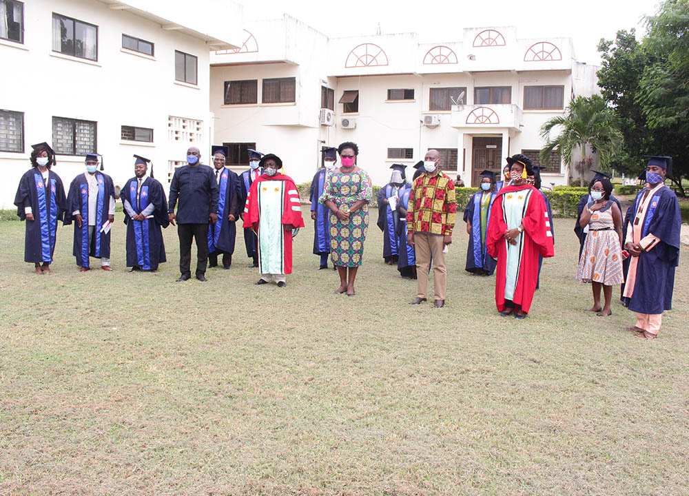 The graduates with the dignitaries