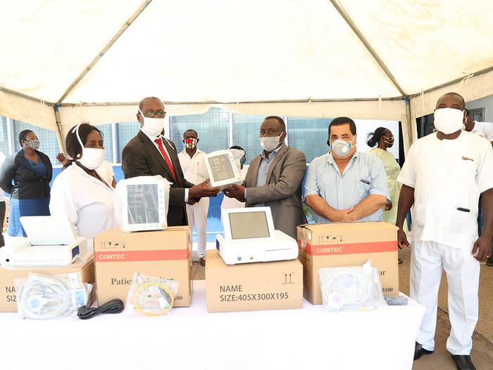 Dr. Daniel Asare presenting the equipment to Dr. Evans Ekanem