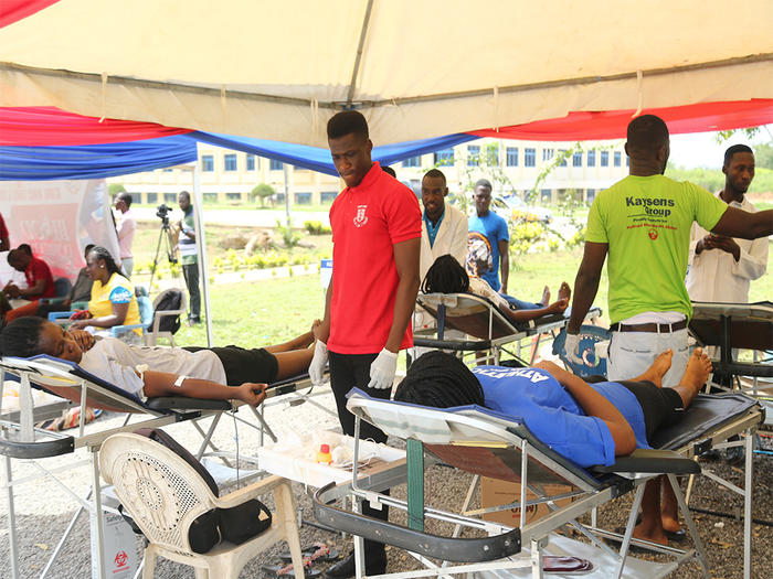 Some students donating blood at the programme