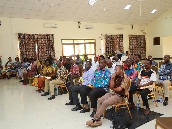 Participants listening to presentations at the workshop