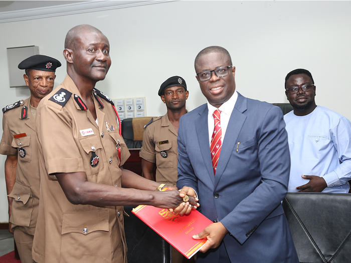 The Vice-Chancellor, Prof. Joseph Ghartey Ampiah, exchanging the signed MoU with the Chief Fire Officer, Mr. Edwin Ekow Blankson