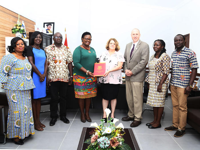 Prof. Dora Edu-Buandoh with the officials from Michigan State University