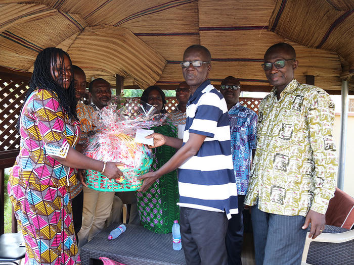 Presentation to former Registrar, Dr. Isaac Ohene at his residence