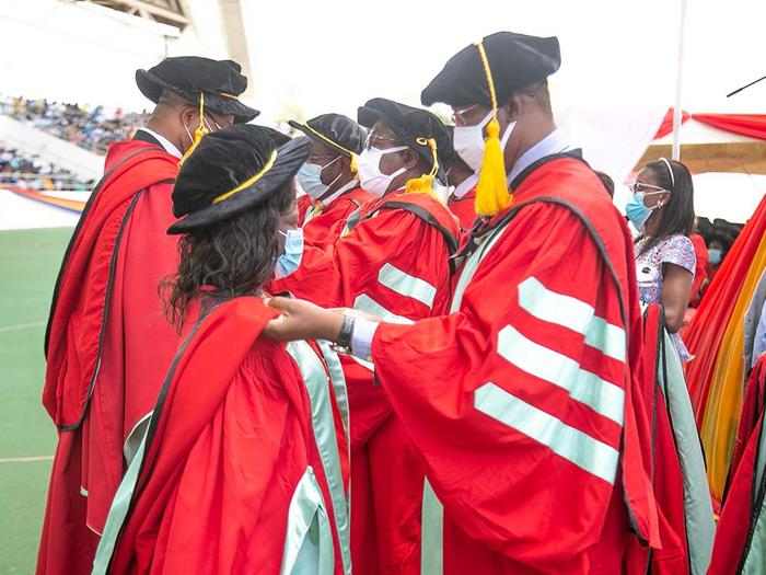 PhD Graduates being robed at the Congregation