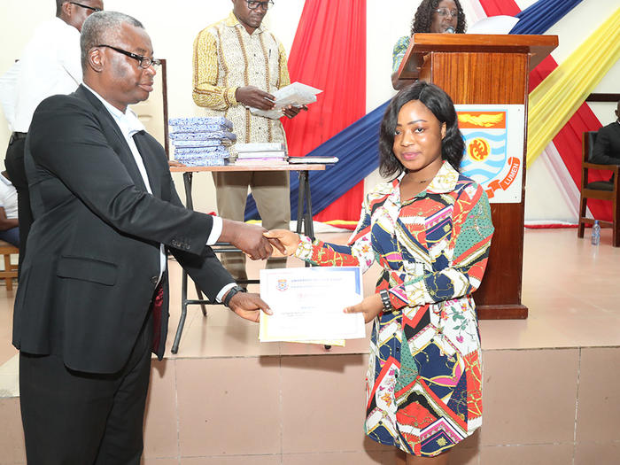 Prof. Amuquandoh presenting an award to a First Class student