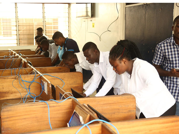 Students voting at Oguaa Hall