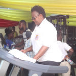 Prof. Dora Edu-Buandoh exercising on one of the sports power/exercise station